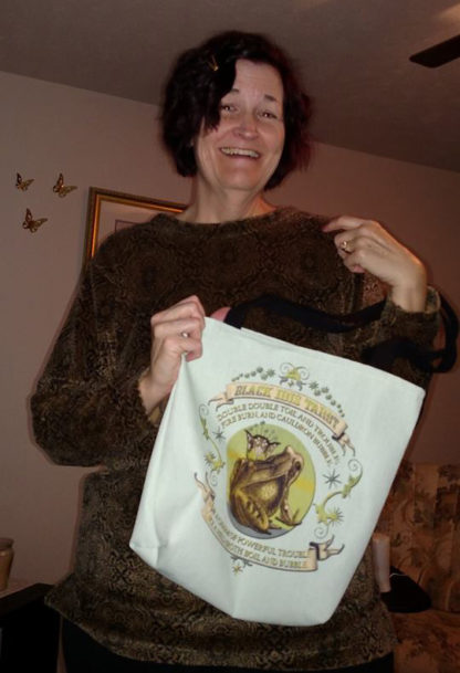 Black Ibis Double Toil and Trouble - Sara showing off her Threadless bag of this design :)